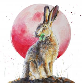 Hare and moon with a four leaf clover