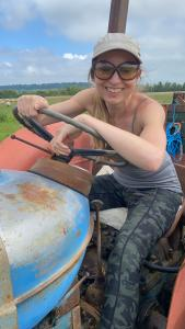 Caroline driving Bessy the tractor