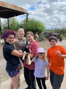Caroline-and-children-at-the-farm-with-rescue-animals-on-children-visit