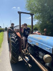 Caroline-driving-the-tractor-with-our-saturday-visitors